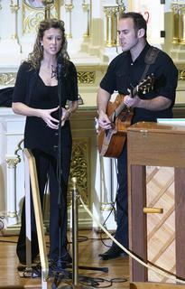 "Robin and Kirk Mays lead the performance of ""Joy to the World, A Christmas Prayer""."