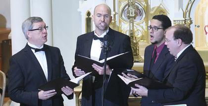 "Robert Lugenbeal, Clay Smith, Higo Rodrigues and Marc Monroe perform ""What Shall We Sing for the Child."""