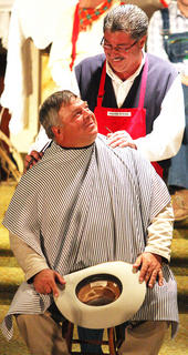 "Archie Campbell (Steven Brady) gives the Sheriff (Doug Thompson) a haircut during a ""Archie's Barber Shop"" skit."