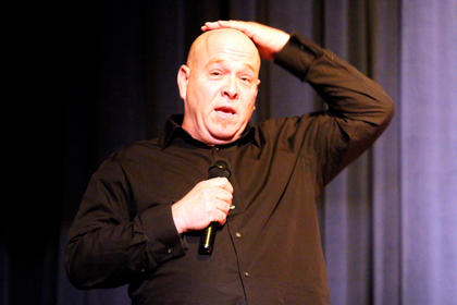 Van Gadberry performs stand-up comedy Friday evening at a Christmas variety show at Centre Square.