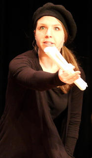 "Emily Simpson Morrow plays the part of the director during ""Holiday Celebrities."""