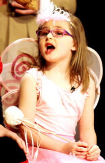 "Ella Gootee plays the part of the Tooth Fairy in ""Holiday Celebrities."""