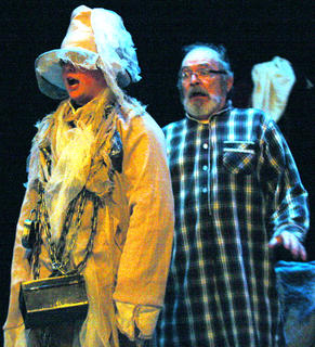 Ebenezer Scrooge, played by Lynn D. Farris, gets a visit from his former business partner Jacob Marley, played by Dawson Pittman.