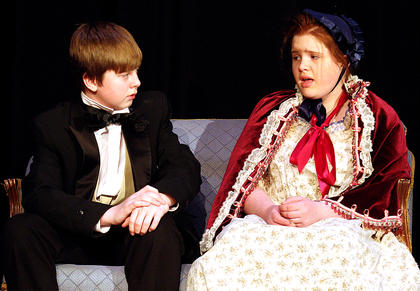 In this scene, a young Ebenezer Scrooge, left, played by Spencer Riggs is heart broken by his fiancé, played by Jenya Loughney.