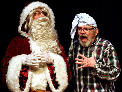 Ebenezer Scrooge, played by Lynn D. Farris, is horrified by what he learns from the ghost of Christmas Present, played by Zachary Brady.