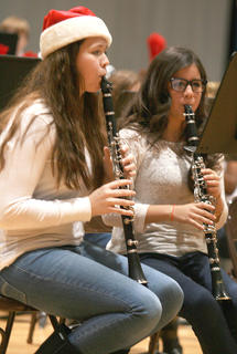 Olivia Ford, left, and Fernanda Reyes keep focused on the music while playing their clarinets.