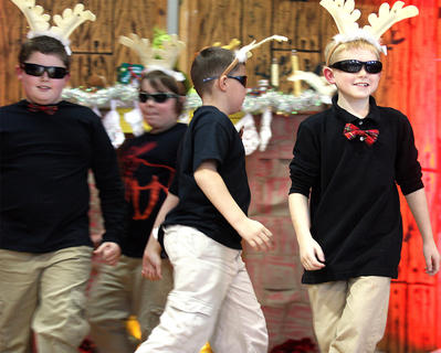 Reindeer prance on stage. They are, from left, Trey Stine,Cage Thomas,Austin Reynolds and Jacob Million.