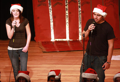"Raley Martin, left, and Jose Zambrano closed the play by leading a performance of ""Don't Stop Believin'""."