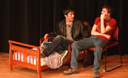 Joe (left, played by Joe Carl) tries to reason with the ghost of Christmas future (Matthew Griffitts) after seeing his future self in prison.