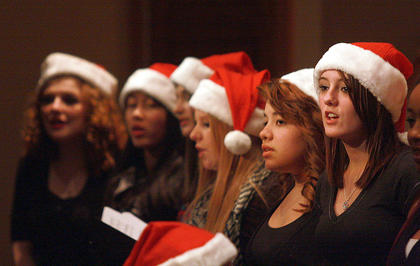 Chorus students sing a Christmas song during a set change. The students who are visible from left are Carrie Fowler, Sara Obata, Natalie Sapp, Megan Newton, Raley Martin, and Jarie Newby.