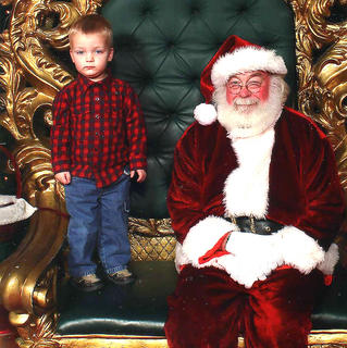 Last year, Finn was so excited to go see Santa, until he got to Santa's Court in the mall. Once his mother, Shantell Marx, was finally able to entice him near the big man, he wouldn't even look at Santa, let alone sit on his lap. No bribery was good enough to get him to sit down on the chair, according to his mom. So, he stood on the chair, as far from Santa as he could get, and wouldn't even look at him.