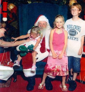 Kaye Piekarski, 3, pleads for her mother, Jena (partially pictured), to rescue her from Santa's lap. Also pictured are Cara, 7, and Chris, 9. This photo was taken on Dec. 23, 2007, while the Piekarski family was living in south Florida.
