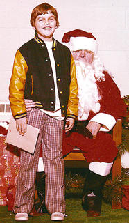 Steve Rucker, who was 11 years old when this photo was taken, poses with Santa Claus during a Christmas bizarre at Lebanon United Methodist Church in 1975.
