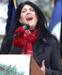 On Saturday, Dec. 17, the annual Wreaths Across America Day ceremony was held at the Lebanon National Cemetery. Tina Mattingly sings the National Anthem during the Wreaths Across America Ceremony Saturday.