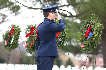 Ryan Herbert salutes after presenting a wreath in memory of those who served and are serving in the United States Air Force.