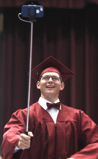 Walter Robey stops for a selfie after receiving his diploma at Marion County High School's graduation.