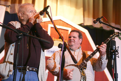 "John Allison, 83, of Pontiac, Ill., plays the harmonica with ""Biscuit"" Davis during the jam session"