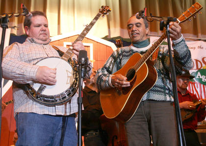 "Gary ""Biscuit"" Davis and Derek Dewes, a native of New Zealand, play a song together Friday evening."