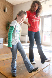 Maria Caldwell, 8, learns a few steps from Melanie Belfiore of Elizabethtown Saturday afternoon at the high school. Belfiore has won multiple clogging titles in Kentucky and Tennessee.