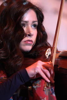 Charli Robertson plays the fiddle with Flatt Lonesome Saturday evening.