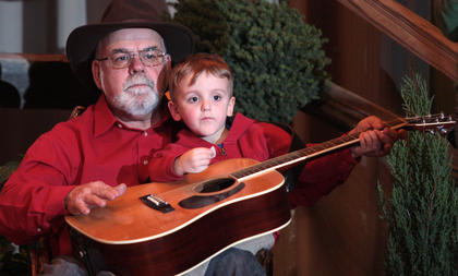 Bobby Mattingly and his grandson, Jacob Huff, shared a seat and a guitar during the jam session Friday evening.