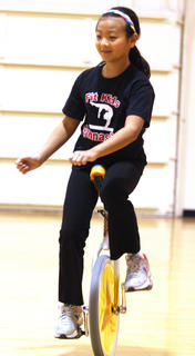 Yuki displays her unique talent of riding a unicycle.