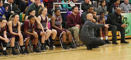 The bench and coaching staff look on as the Lady Knights pulled away late for a 65-43 win over Elizabethtown in the regional semifinal game.