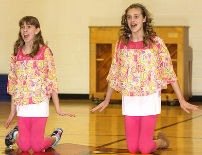 "From left, sisters Jessica and Cassandra Thomas sing a song from the movie, ""Frozen."""