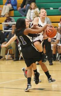 Jordan Thomas draws a foul as she gets off a shot in the 5th Region Tournament win over Washington County.