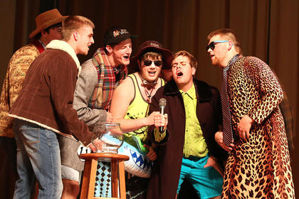 Participants in the Spectre group come together to sing a Justin Bieber song during the poise portion of the competition. They are, from left, Conner Mattingly, Travis Huellemeier, Cody Rogers, Daniel Maupin and Jared Tutt.