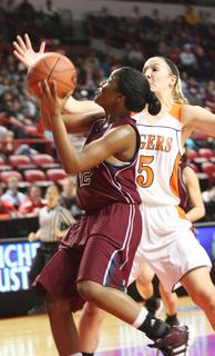 Junior Patrice Tonge drives by her defender for two of her 18 points in the 37 point win over Hopkinsville on Friday night.