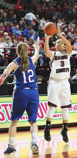 Senior Makayla Epps pulls up for a shot in the 71-32 win over Montgomery County.  Epps led all scorers with 22 points.