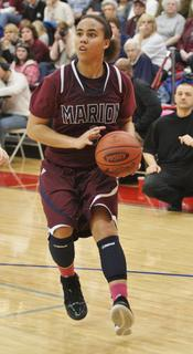 Makayla Epps looks to pull up for a shot at Adair County High School in the Lady Knights win over Adair County in the 20th district championship game.