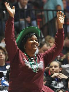 Lady Knight fan Kim Bell cheers on as Marion County routs Hopkinsville 67-30 on Friday night.