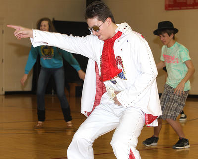 Kelly Mattingly, as Elvis, shows off his dance moves.