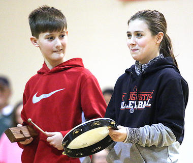 Henry Mattingly and Ann Presley Thompson play instruments during a performance by the fourth and sixth grade classes at St. A.