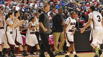 The Marion County players and coaches get excited after a run against Anderson County forces a timeout.