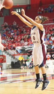 Haeli Howard shoots a three point goal in the semifinal game against Lincoln County.