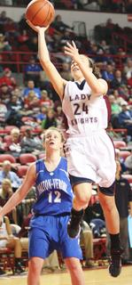 Senior Bre Elder goes up for a shot in the first round game of the state tournament against Walton-Verona.