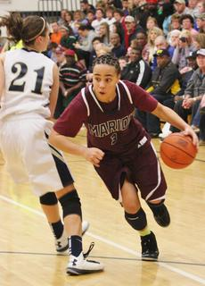 Makayla Epps drives past her defender for two of her game high 21 points in the Lady Knights win over Elizabethtown.