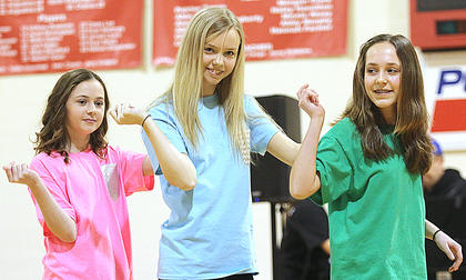 Aubrey Mealey, Sophie Thomas and Josie Followell perform an original dance routine.
