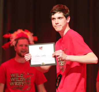 Noah Leake poses proudly with his poise award.