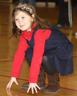 Katie Zink performs with her classmates during a talent show at St. Augustine Friday morning.