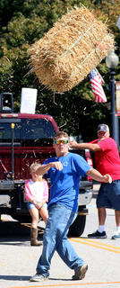 Taylor Gadhart competes in the hay bale toss on Sunday at Ham Days.