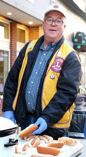 Terry Mills serves free hot dogs with the Lebanon Lions Club Friday evening.