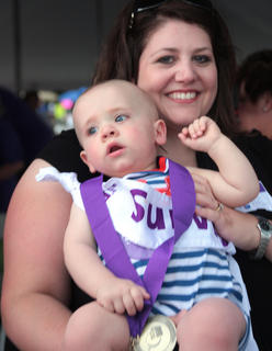 Landon Thompson, 11 months, is the youngest cancer survivor at this year's Relay for Life. His mother, Stephanie, carried him to receive his survivor's medal.