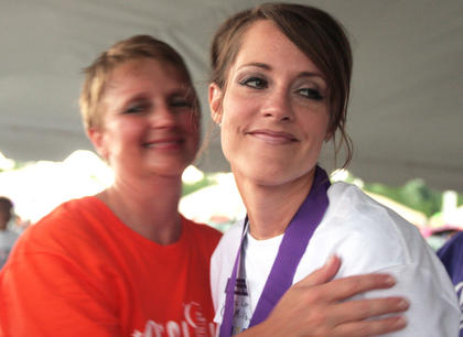 Lori Jo Milby smiles after receiving her survivor&#039;s medal.