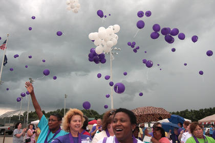 Marion County Relay for Life participants release balloons to celebrate just before the rain came down Friday evening at Graham Memorial Park.