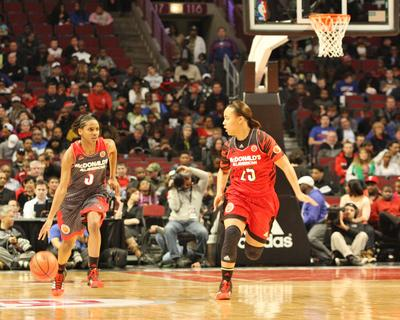 At the United Center in Chicago last Wednesday night, Marion County's Makayla Epps guards a West team player as she brings the ball up the court.