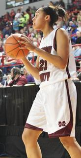 Junior Alexus Calhoun looks for an open teammate.